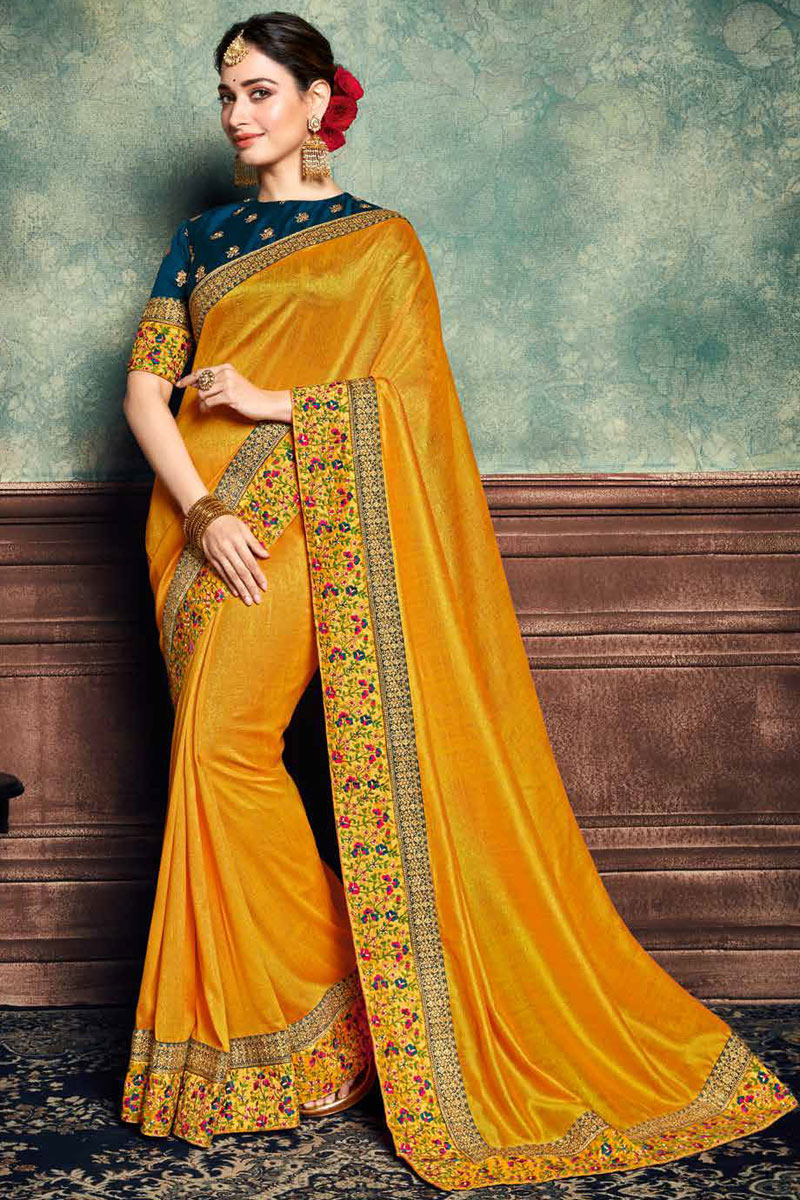 Eid Special Tamannaah Bhatia Featuring Function Wear Art Silk Fabric Embroidery Work On Saree In Yellow Color With Alluring Blouse