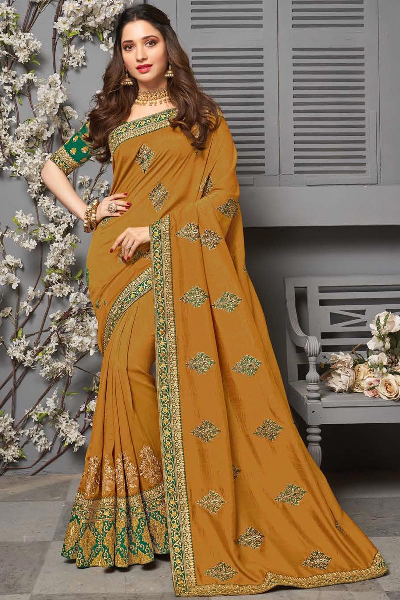 Tamanna Bhatia Sangeet Wear Art Silk Fabric Mustard Color Embroidered Border Work Saree