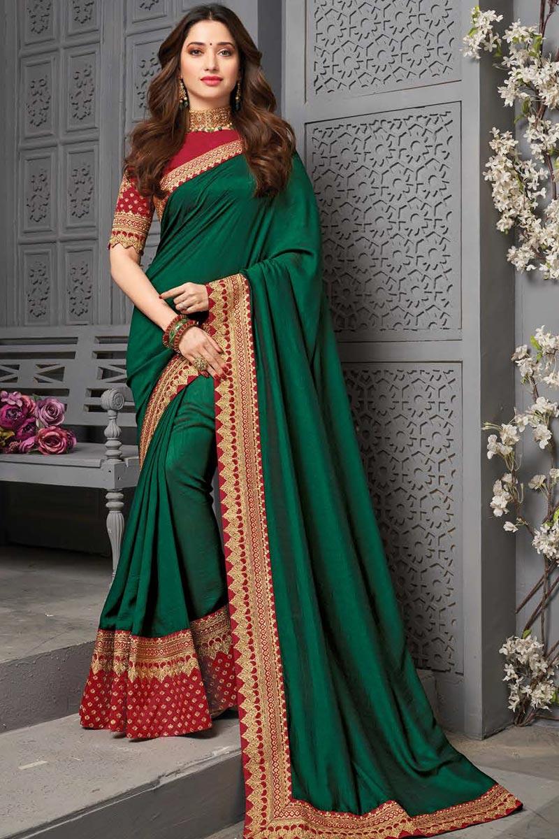 Tamanna Bhatia Dark Green Color Sangeet Wear Embroidered Border Work Saree In Art Silk Fabric