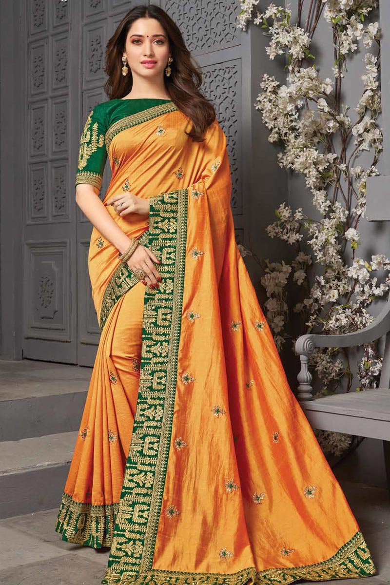 Tamanna Bhatia Party Wear Art Silk Fabric Orange Color Embroidered Border Work Saree