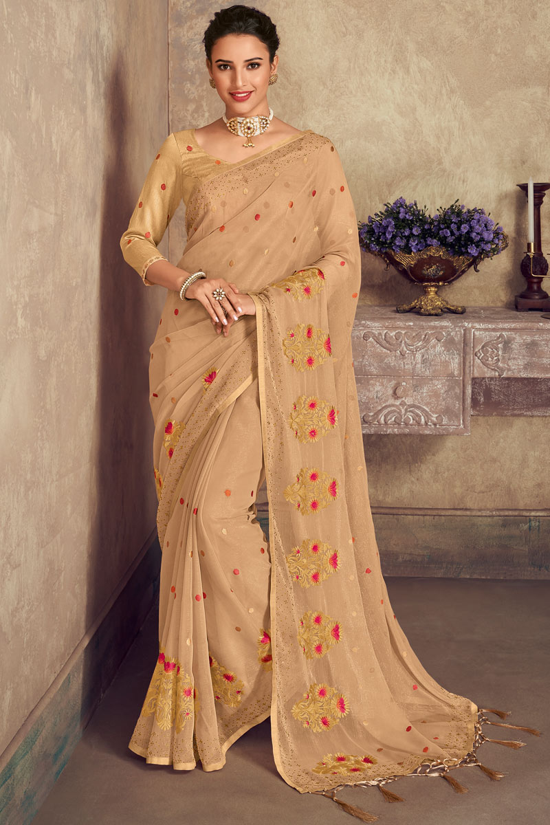 Embroidery Designs On Chiffon Fabric Occasion Wear Saree In Chikoo Color With Enticing Blouse