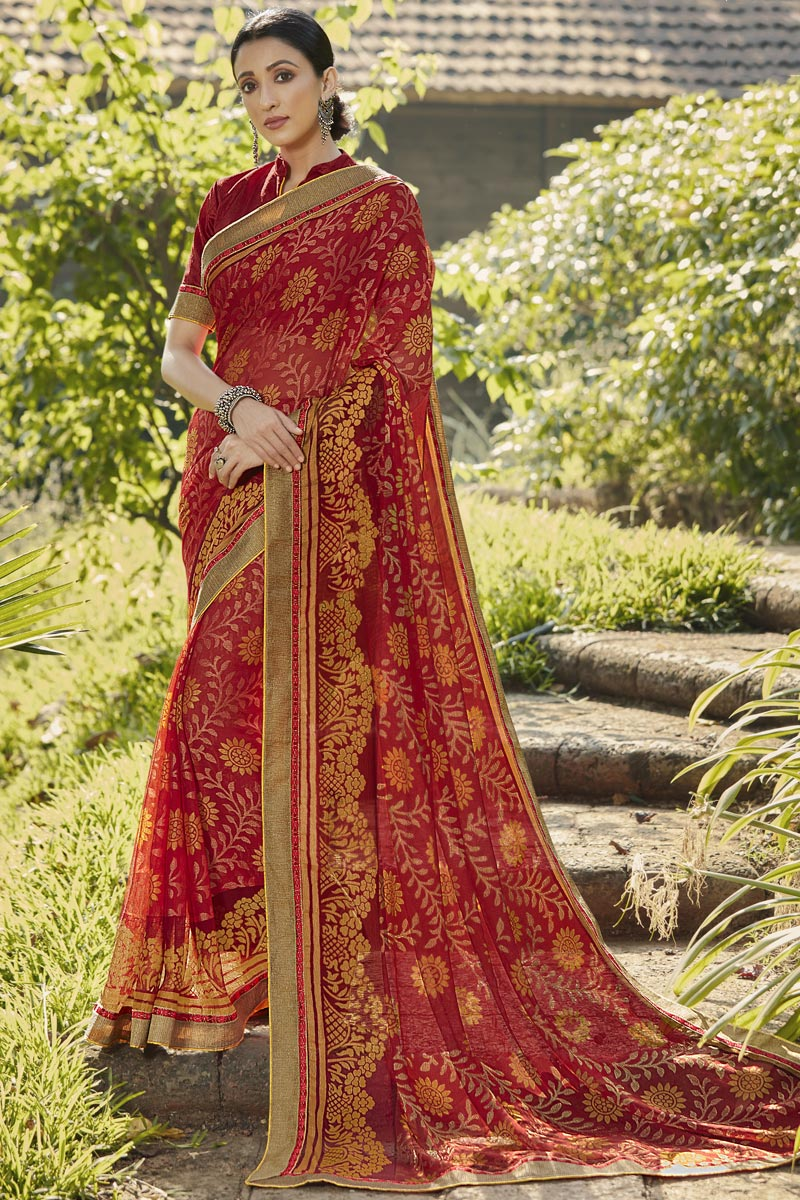 Brasso Fabric Festive Wear Fancy Printed Saree In Maroon Color