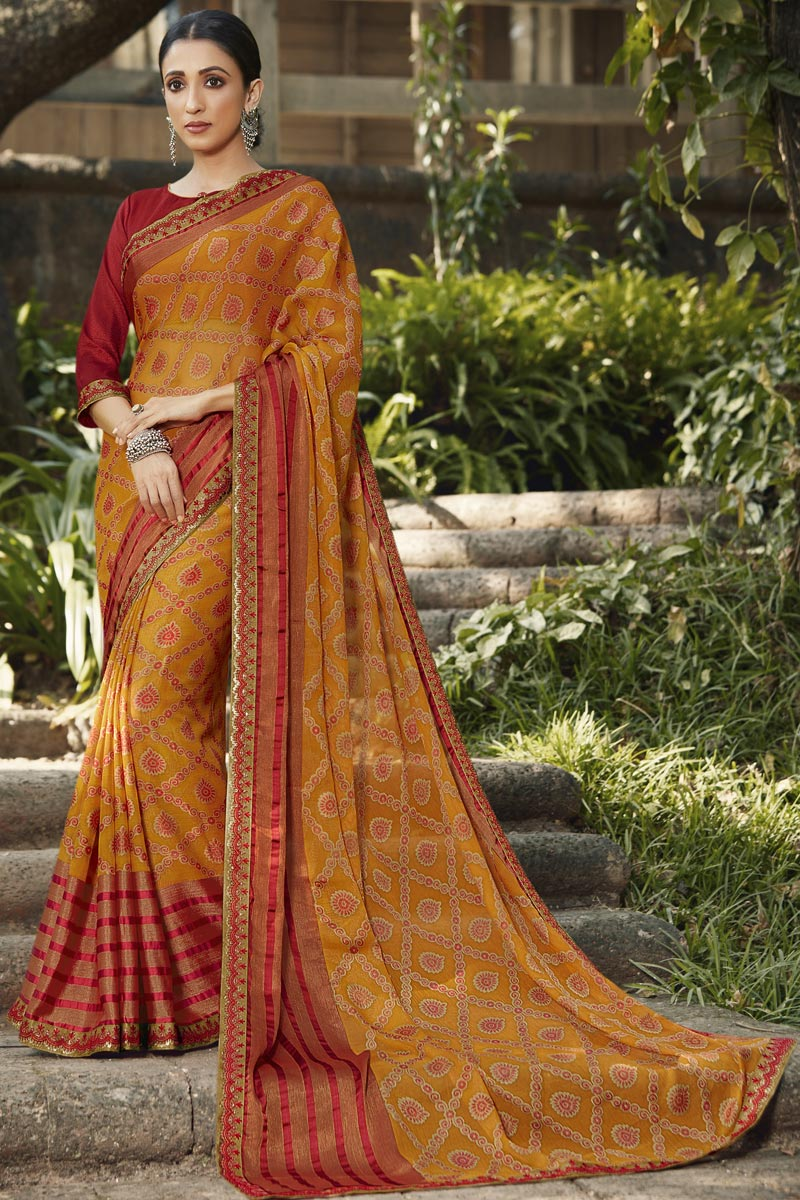 Brasso Fabric Festive Wear Orange Color Fancy Printed Saree