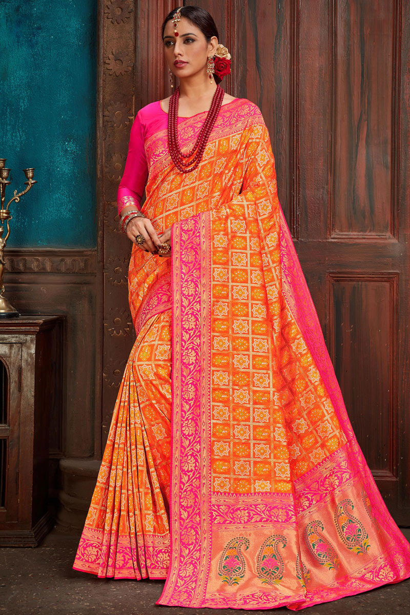 Eid Special Weaving Work On Orange Silk Fabric Designer Saree With Captivating Blouse