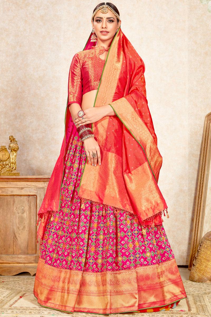 Weaving Work Wedding Wear Lehenga Choli In Art Silk Rani Color With Fancy Dupatta