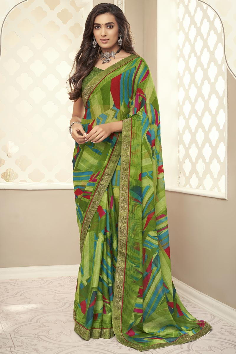 Fancy Chiffon Fabric Printed Daily Wear Green Color Saree