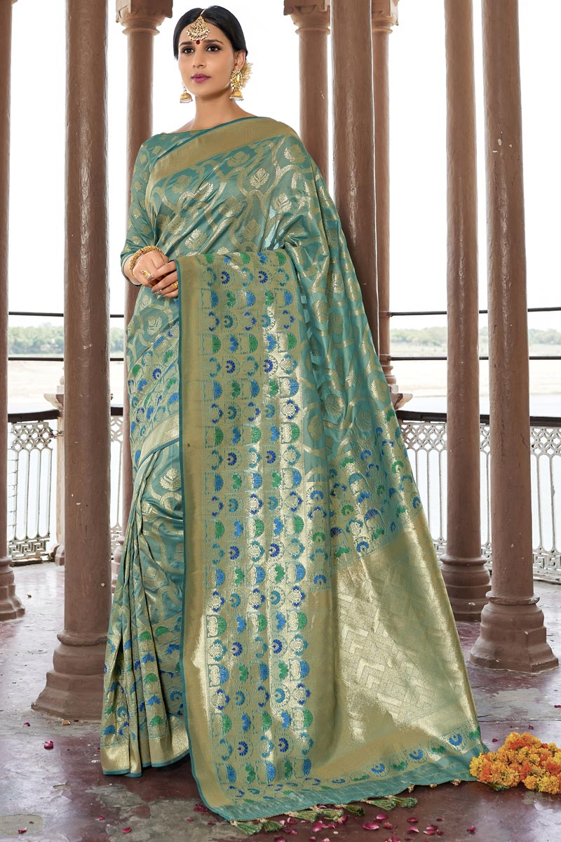 Eid Special Traditional Function Wear Cyan Color Weaving Work Designer Saree In Silk Fabric
