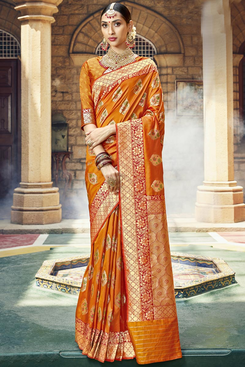 Occasion Wear Fancy Orange Color Saree In Silk Fabric With Weaving Work