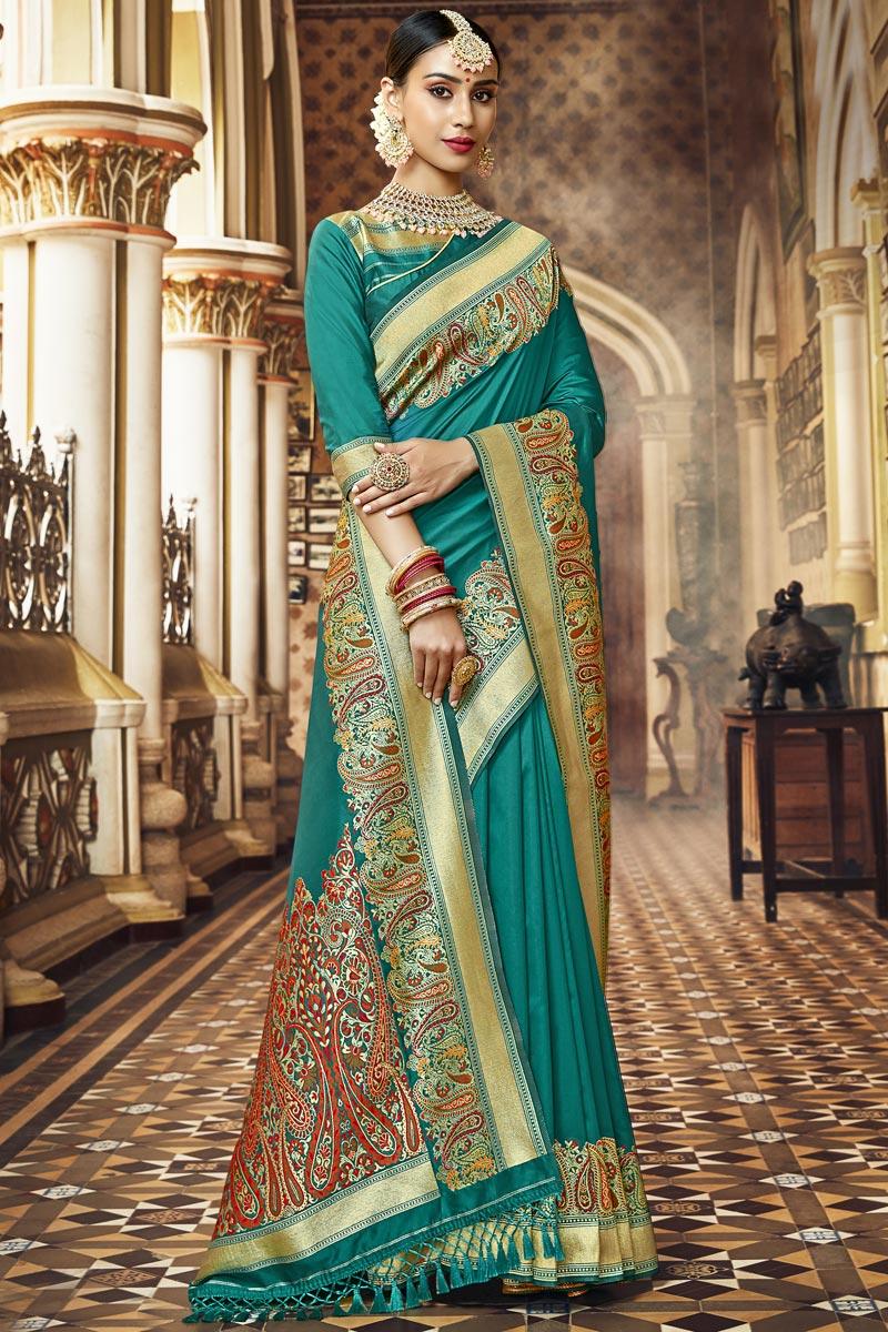 Traditional Wear Cyan Color Fancy Weaving Work Saree In Silk Fabric