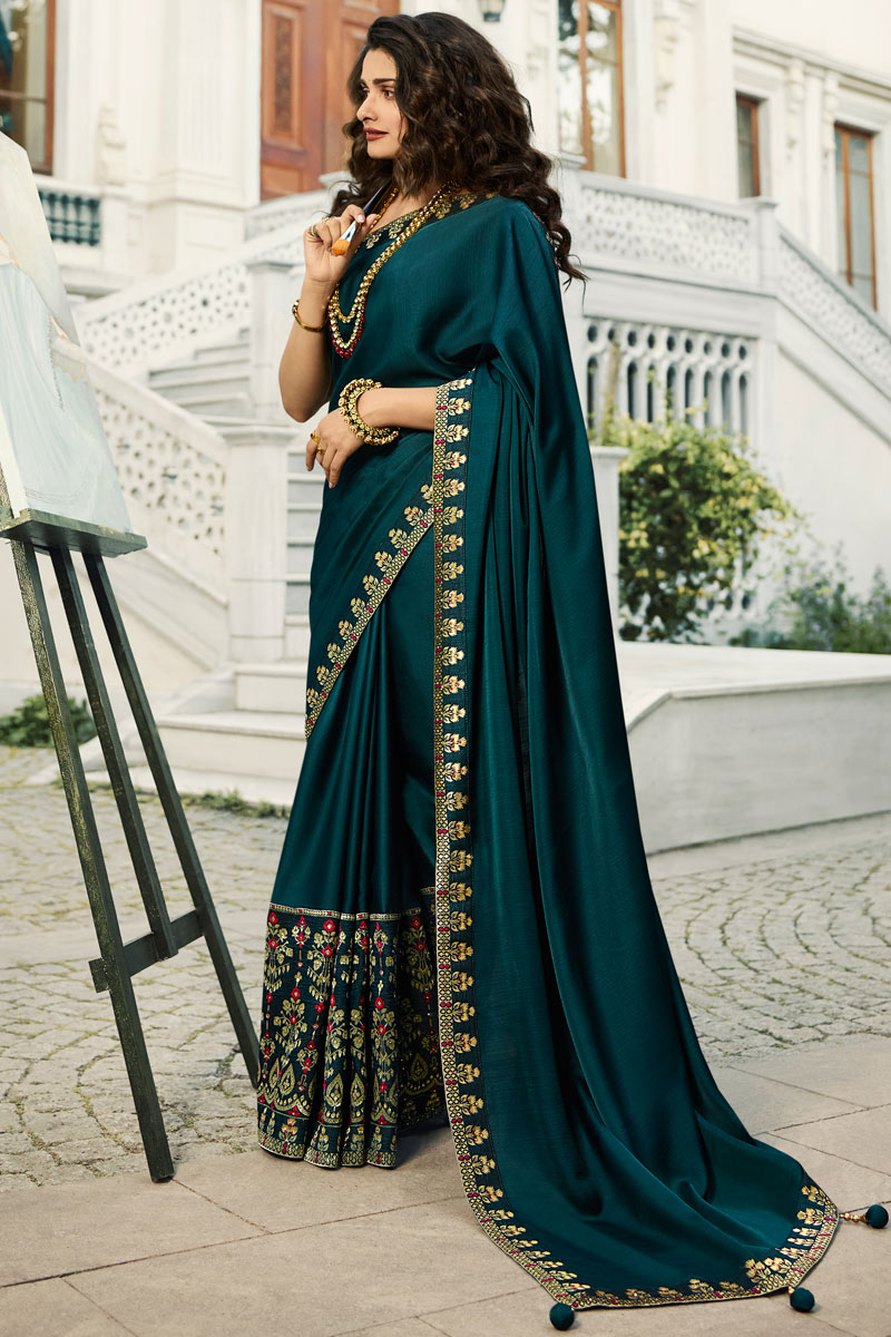 Eid Special Prachi Desai Embroidery Designs On Teal Color Art Silk Party Wear Saree With Designer Blouse