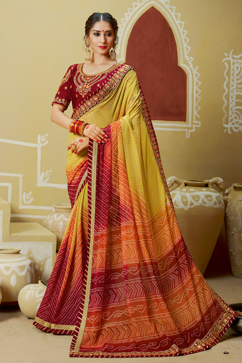 Lace Work On Georgette Fabric Yellow Color Bandhani Style Saree