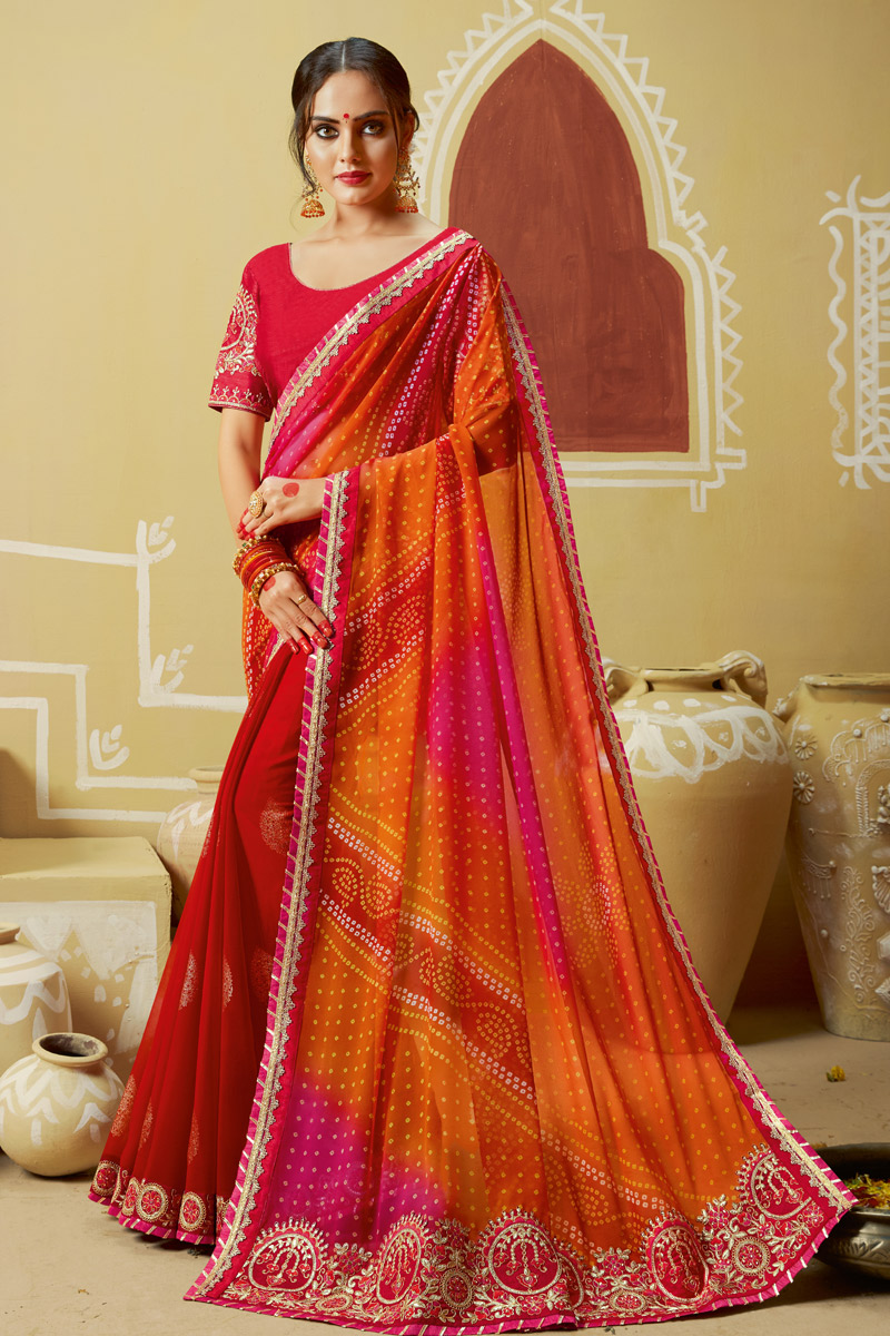 Orange Color Georgette Fabric Casual Wear Saree In Bandhani Style