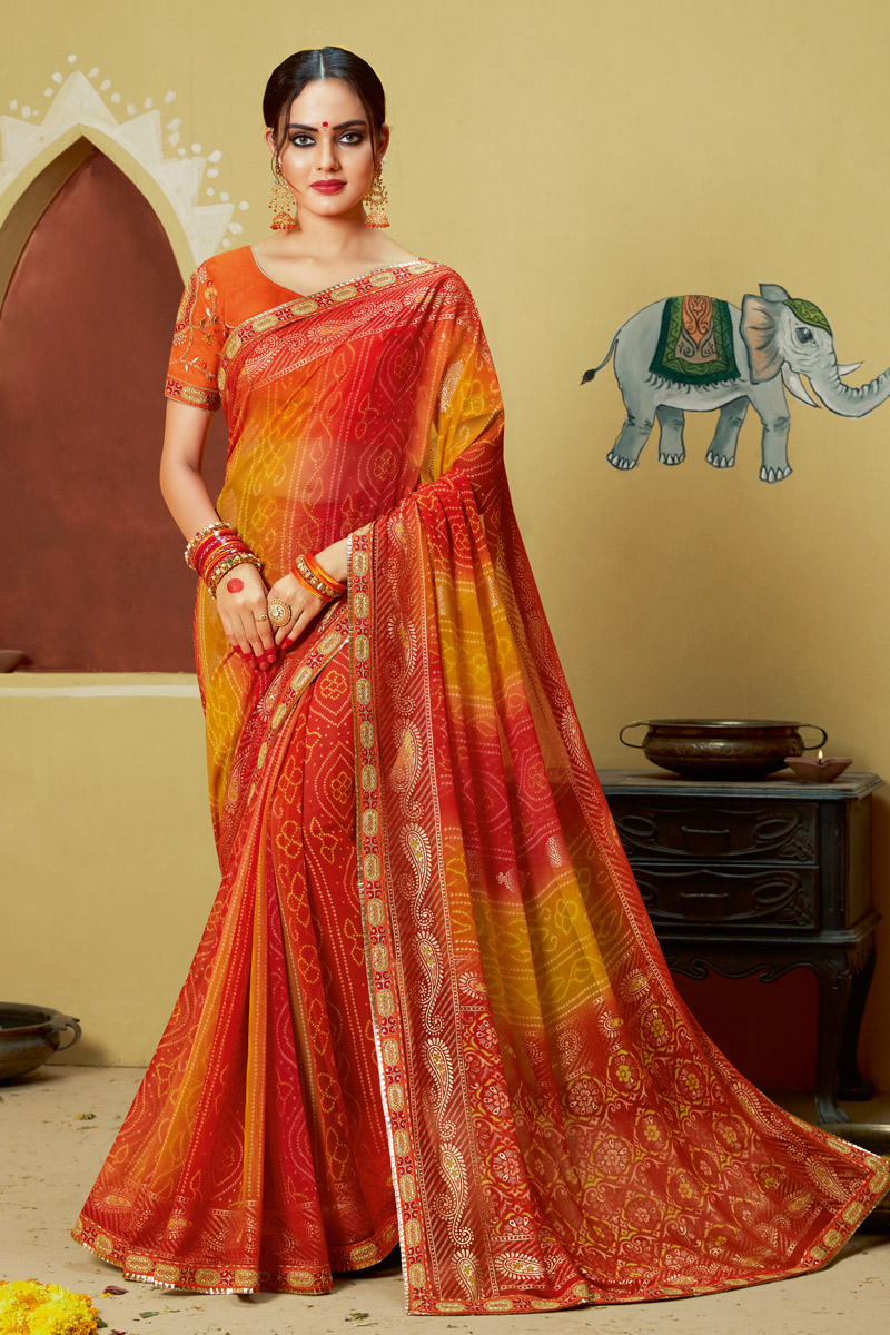 Lace Work On Orange Color Georgette Fabric Bandhani Style Saree