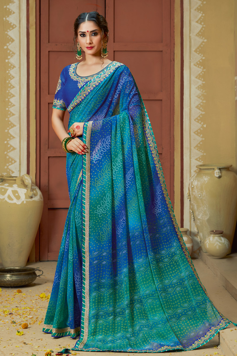 Lace Work On Georgette Fabric Designer Bandhani Style Saree In Blue Color With Attractive Blouse