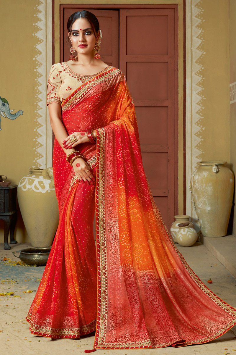 Function Wear Georgette Fabric Lace Work Bandhani Style Saree In Red Color With Party Wear Blouse