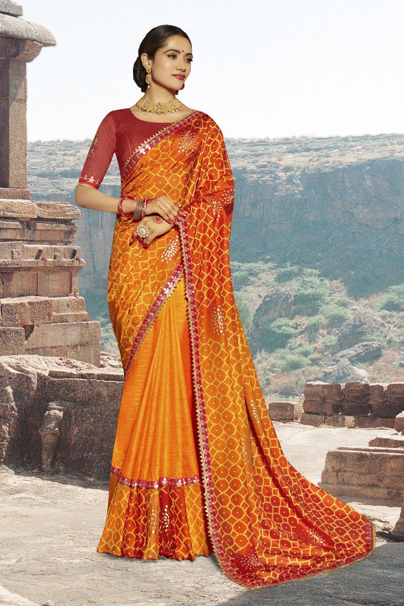 Georgette Fabric Orange Fancy Festive Wear Bandhani Printed Saree