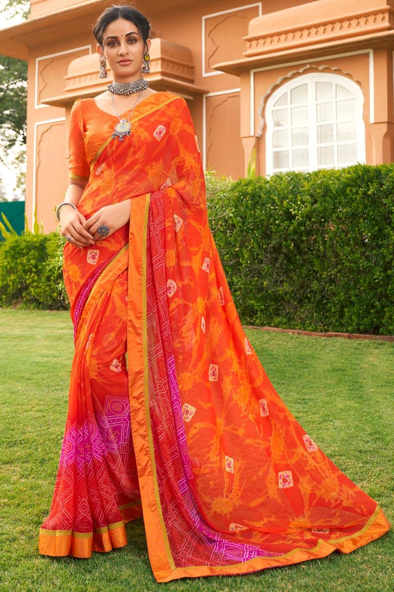 Festive Wear Orange Color Satin Fabric Fancy Bandhej Print Saree
