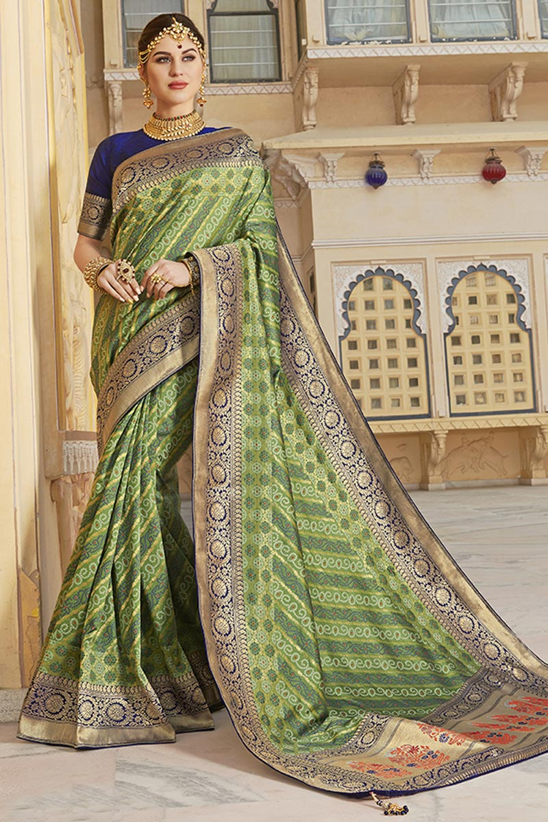 Function Wear Silk Fabric Trendy Weaving Work Saree In Green Color