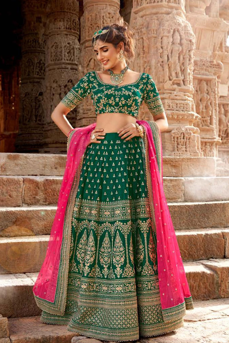 Net Fabric Dark Green Color Reception Wear Lehenga Choli With Embroidery Work