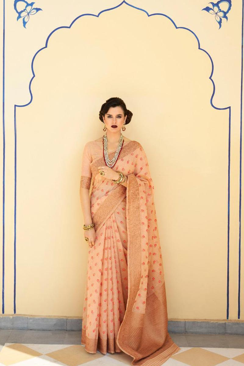 Linen Fabric Sangeet Wear Classic Peach Color Weaving Work Saree