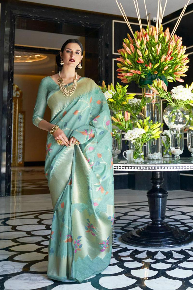 Cyan Color Linen Fabric Traditional Wear Elegant Weaving Work Saree