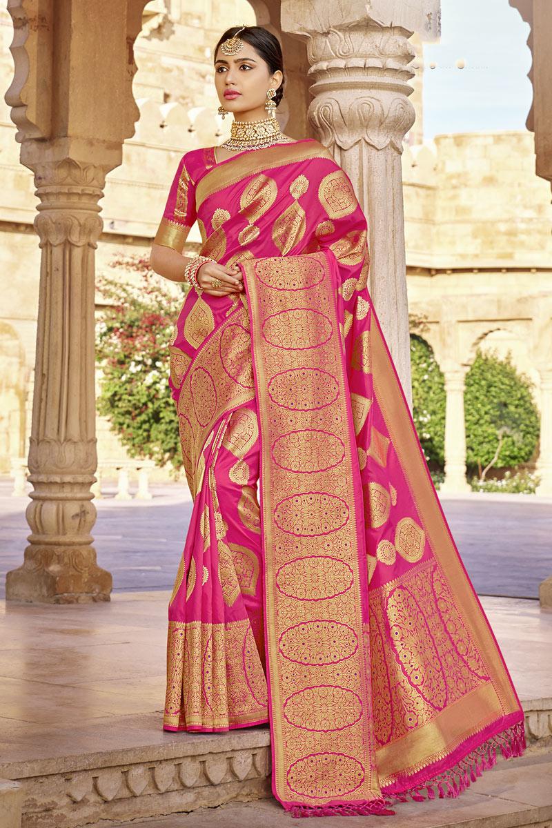 Weaving Work Designs On Rani Color Occasion Wear Saree In Banarasi Silk Fabric
