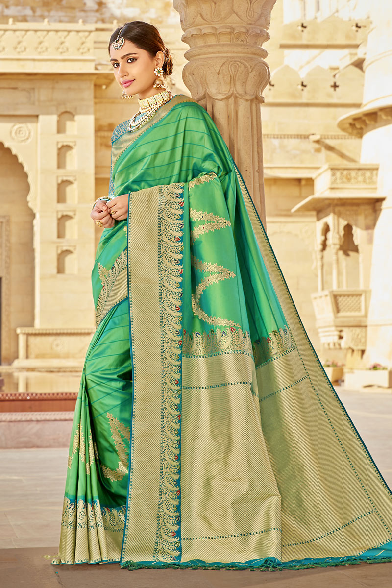 Banarasi Silk Fabric Green Color Party Wear Saree With Weaving Work