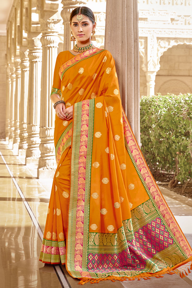 Weaving Work On Designer Saree In Orange Color Banarasi Silk Fabric
