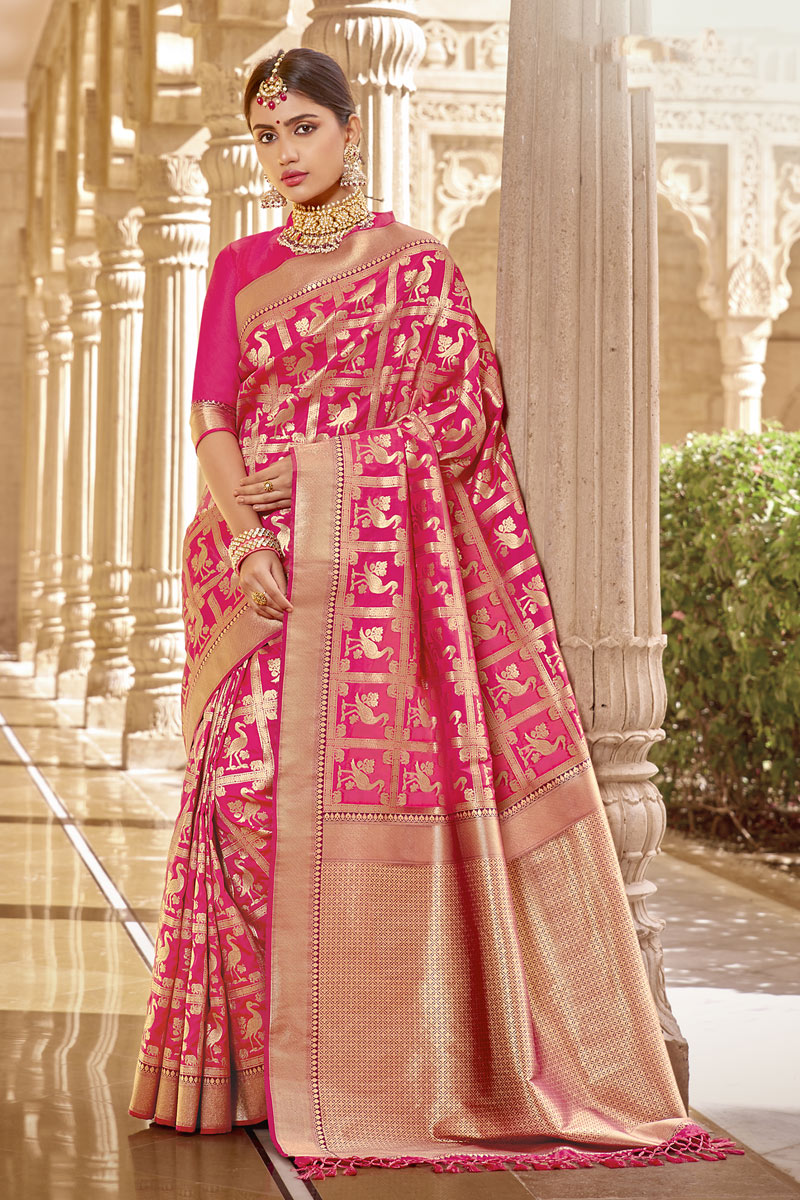 Banarasi Silk Fabric Designer Party Wear Saree In Rani Color With Weaving Work