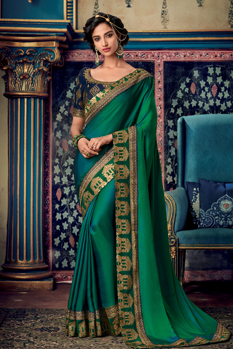 Embroidery Work On Fancy Fabric Designer Saree In Dark Green Color