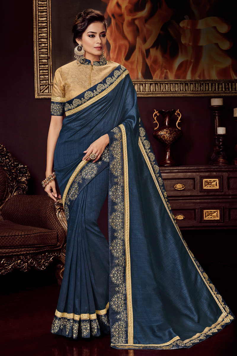Designer Saree In Navy Blue Color Fancy Fabric With Embroidery Work And Party Wear Blouse