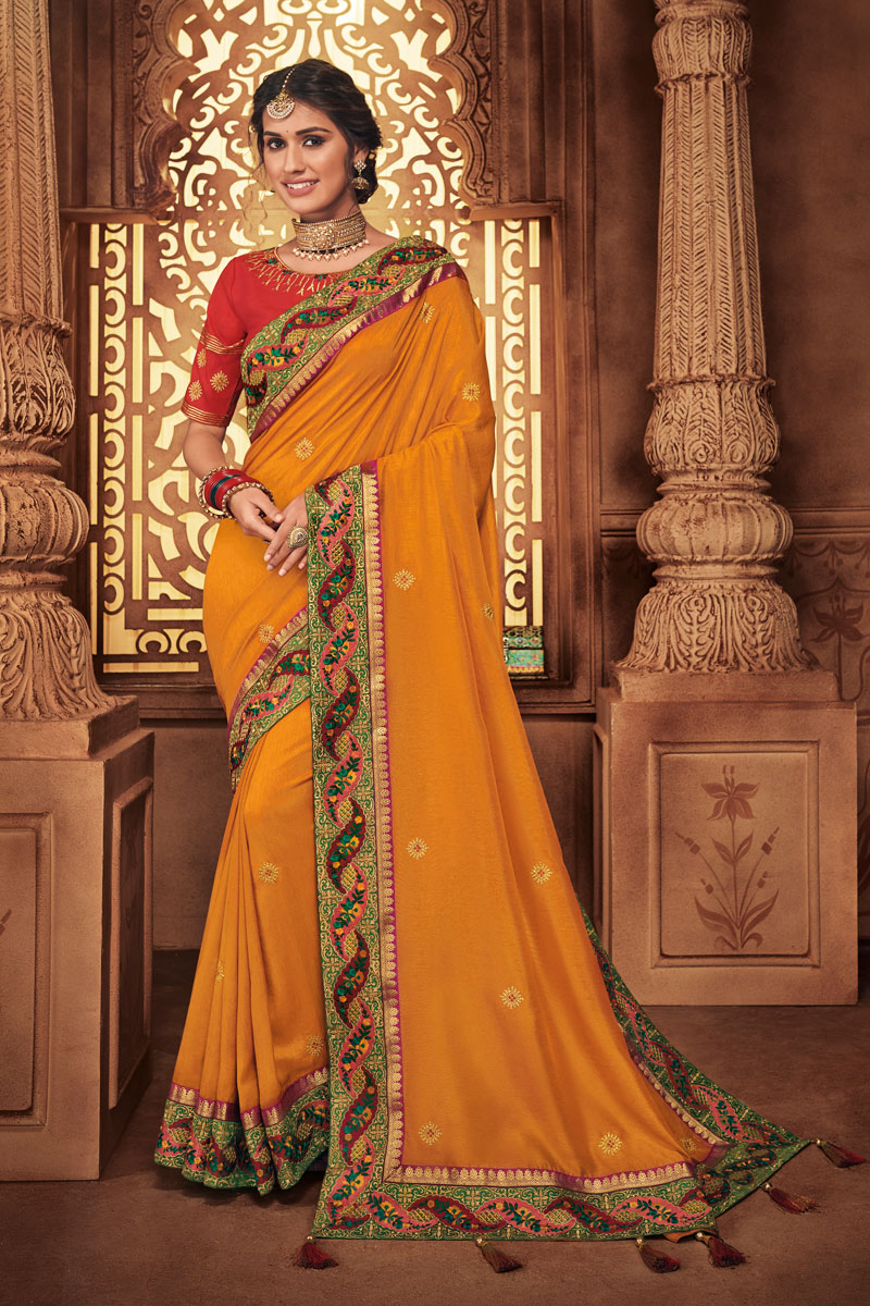 Embroidered Fancy Fabric Orange Color Designer Saree With Mesmerizing Blouse