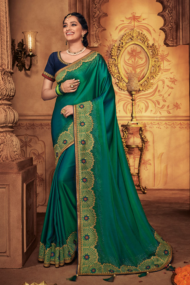 Embroidered Work On Dark Green Color Fancy Fabric Designer Saree With Captivating Blouse