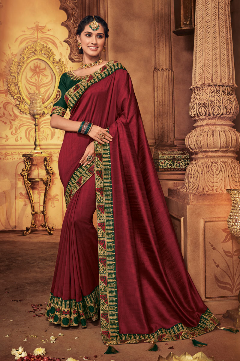 Maroon Color Fancy Fabric Party Wear Saree With Embroidered Designs And Tempting Blouse