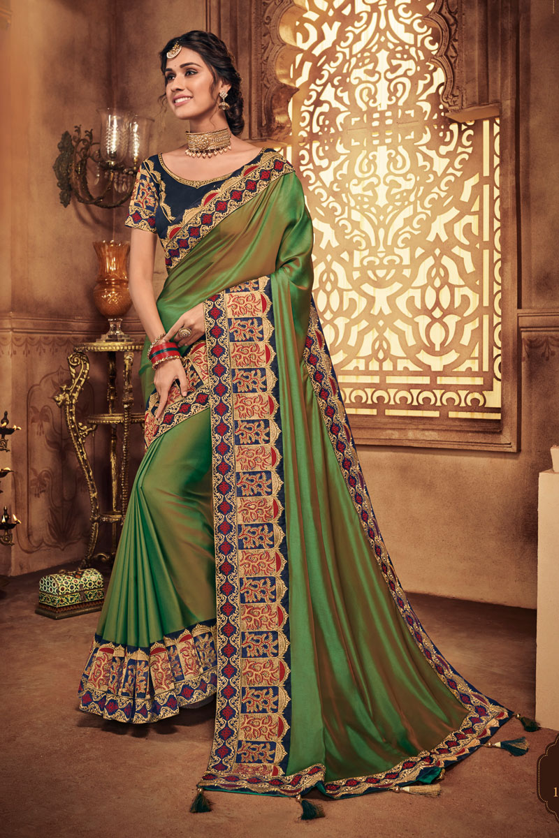 Green Color Party Wear Saree In Fancy Fabric With Embroidery Work And Beautiful Blouse