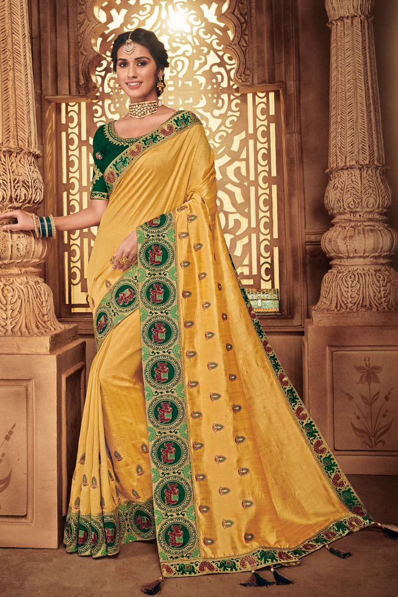 Fancy Fabric Golden Color Festive Wear Saree With Embroidery Work And Attractive Blouse