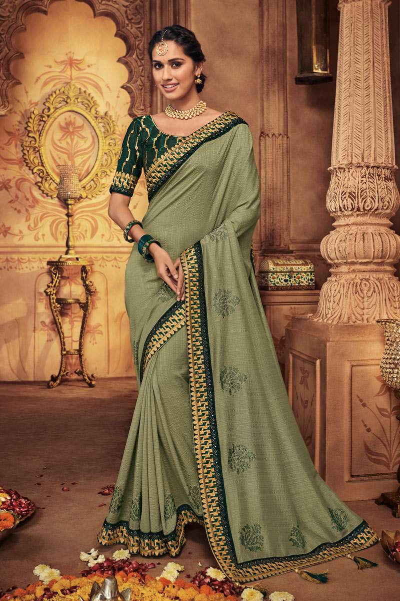 Embroidery Work On Fancy Fabric Green Color Function Wear Saree With Marvelous Blouse