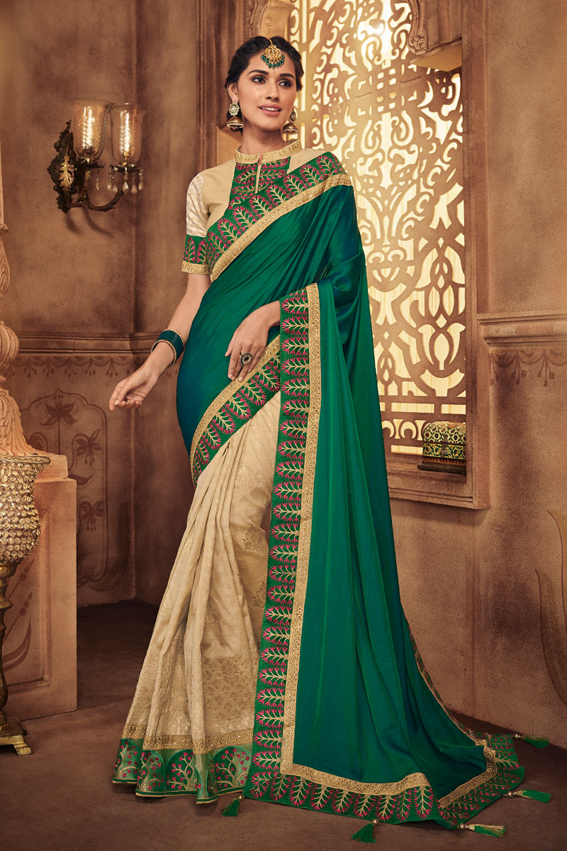 Fancy Fabric Embroidery Designs On Dark Green Color Reception Wear Saree With Attractive Blouse