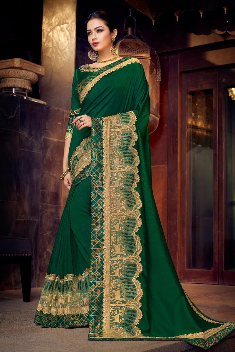 Fancy Fabric Dark Green Color Occasion Wear Saree With Embroidery Work And Attractive Blouse
