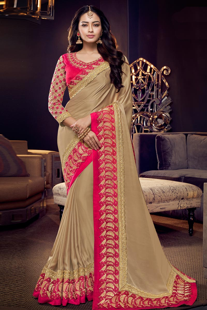 Fancy Fabric Chikoo Color Occasion Wear Saree With Embroidery Work And Elegant Blouse