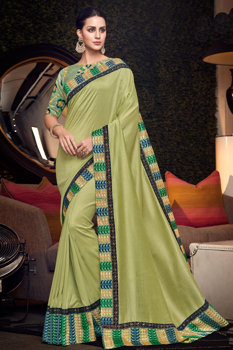 Khaki Color Fancy Fabric Party Wear Saree With Embroidery Work And Beautiful Blouse