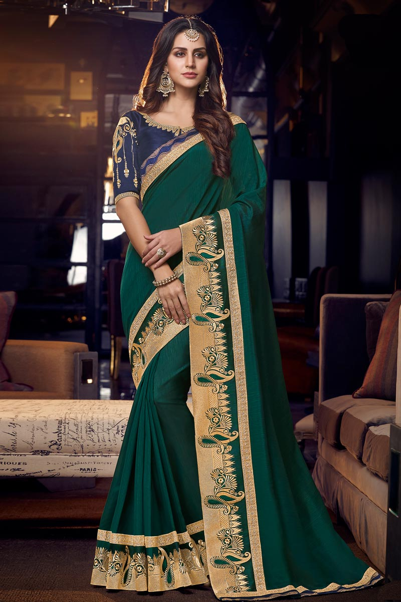 Occasion Wear Fancy Fabric Saree In Teal Color With Embroidered Border And Blouse