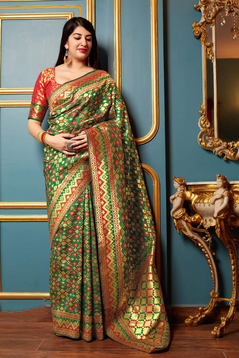 Banarasi Silk Fabric Green Color Party Wear Saree With Weaving Work And Enigmatic Blouse