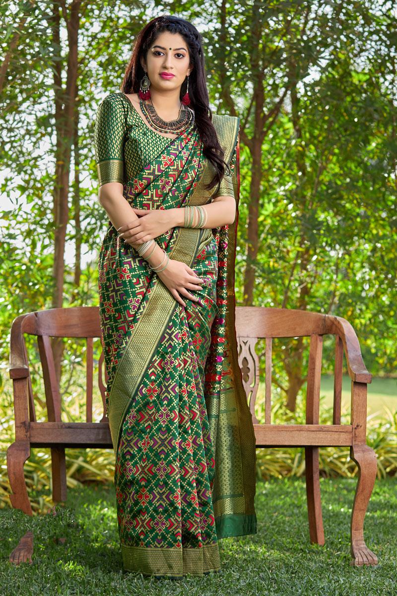 Banarasi Silk Fabric Weaving Work Designs On Dark Green Color Reception Wear Saree