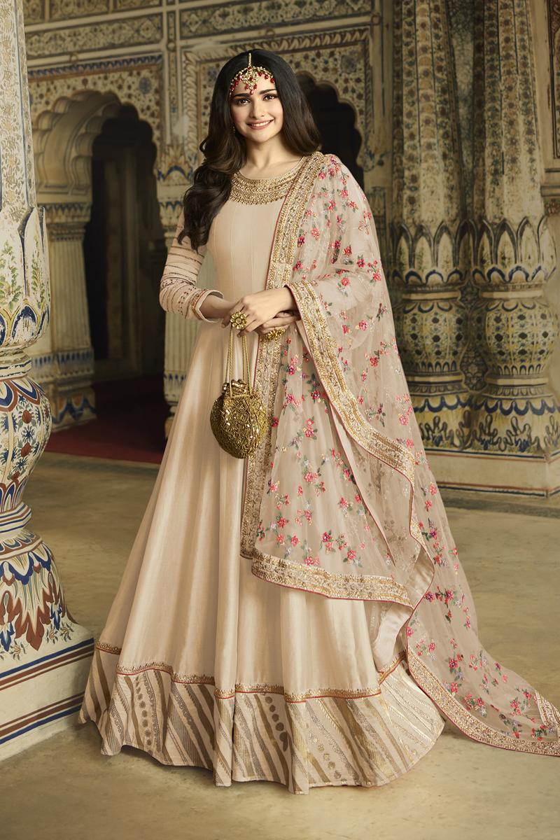 Prachi Desai Fancy Fabric Party Wear Anarkali Salwar Suit In Chikoo Color