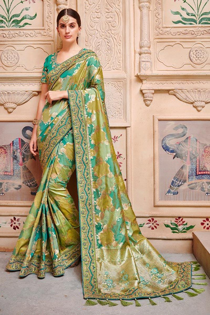 Banarasi Silk Party Wear Saree In Green With Border Work And Designer Blouse