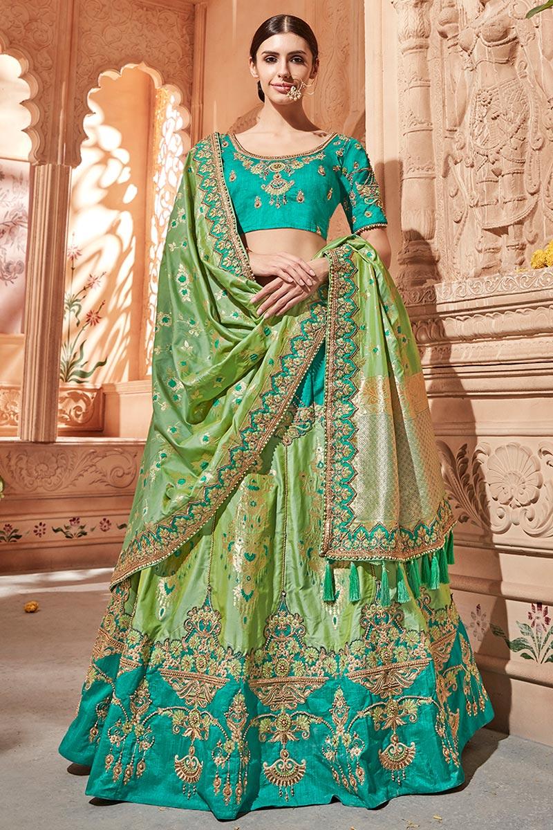 Best Selling Wedding Wear Designer Embroidered Lehenga In Art Silk Fabric Sea Green