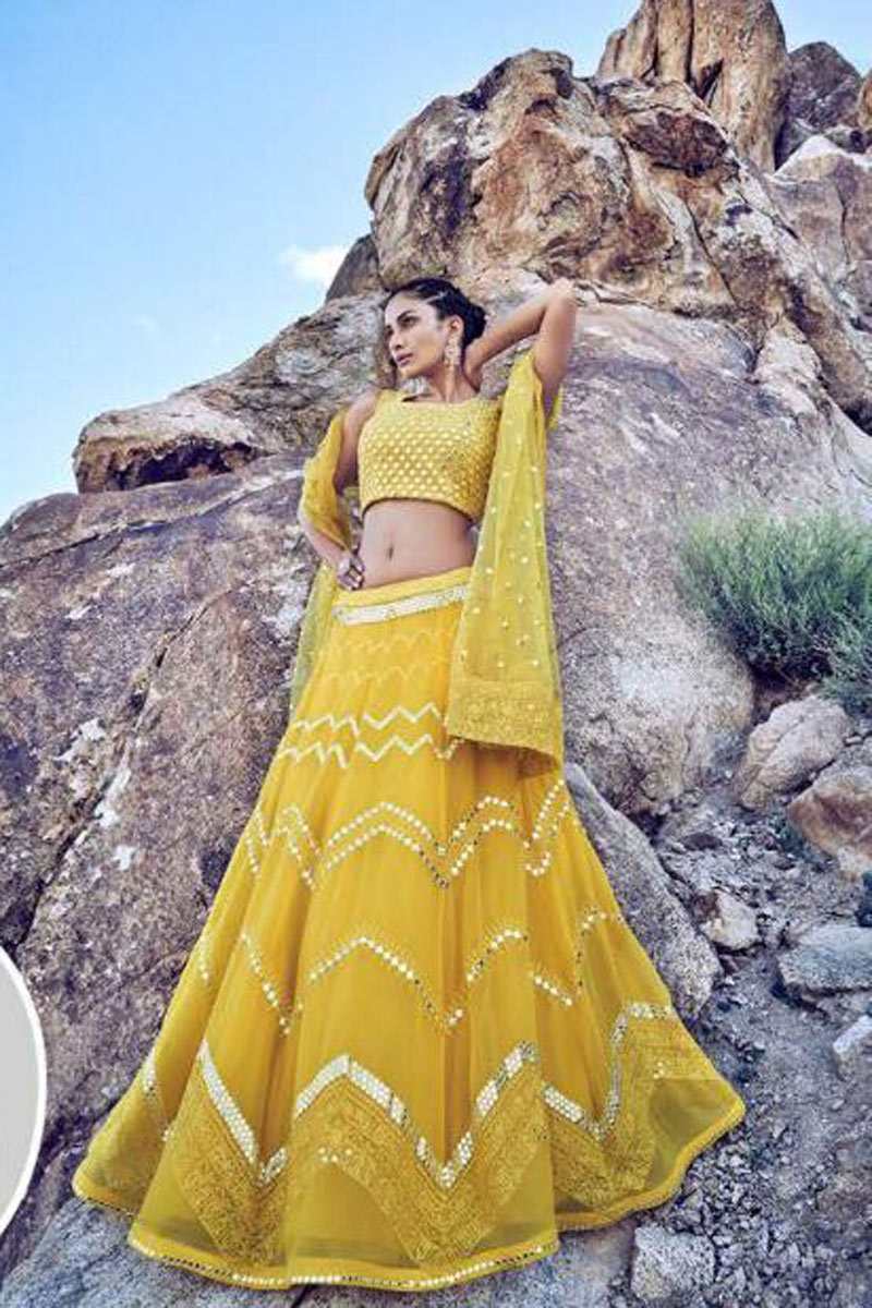 Eid Special Yellow Net Fabric Sangeet Wear 3 Piece Embroidered Lehenga With Enigmatic Blouse