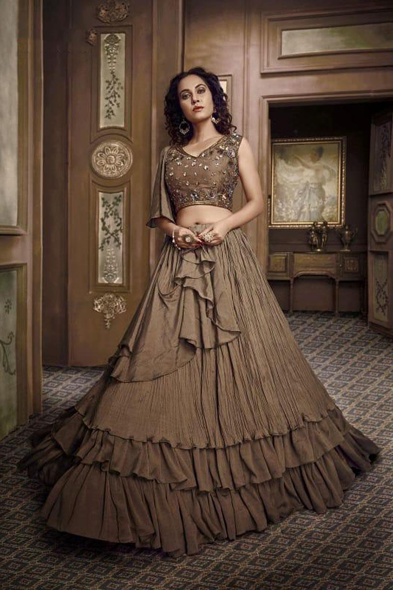 Fancy Fabric Brown Reception Wear Lehenga Choli With Hand Work