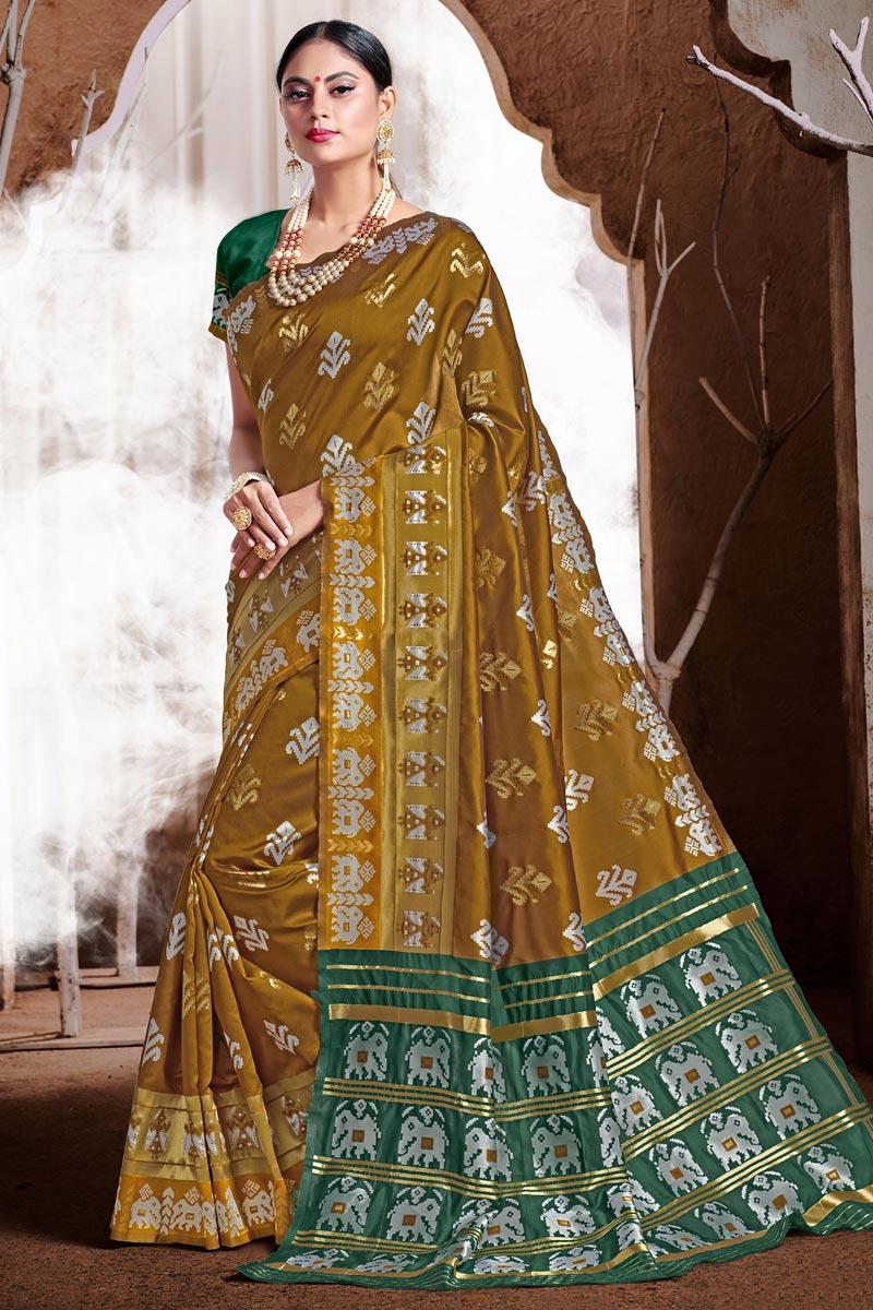 Trendy Puja Wear Khaki Color Weaving Work Saree In Art Silk Fabric